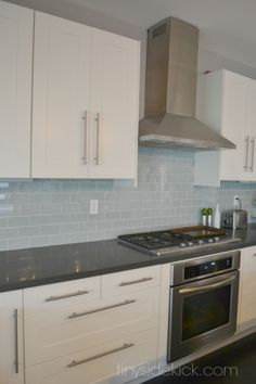 to Create a Color Palette For Your Home kitchen with baby blue glass subway tiles 3 x the Blue Into the Blue may refer to: Blue Kitchen Tiles, Blue Backsplash, Subway Tile Kitchen, White Kitchen Cabinets, Kitchen Colors, New Kitchen, Kitchen Decor, Kitchen Design, Subway Tiles
