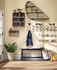 A little birdie told us that wall shelves are great for the entryway. HomeDecorators.com