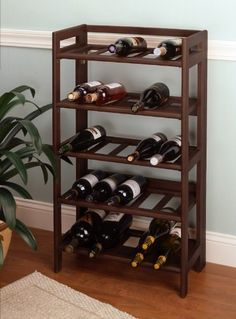 Winsome 25 Bottle Foldable and Stackable Wine Rack by Winsome. $72.20. Some assembly may be required. Please see product details.. The 25 Bottle Folding Wine Rack has the ability to store both standard and magnum bottles. Made of solid hardwood with walnut finish, this wooden wine rack stores up to 25 bottles of wine. This rack even allows you to stack standard size bottles on top of each other. This is a must-have for those holiday parties and can be easily stored after...