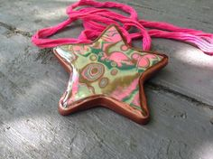 Items similar to Stunning OOAK designer pendant. Resin coated star shape with bronze bezel. on Etsy Resin Coating, Polymer Clay Beads, Star Shape, Unique Jewelry, Bronze, Handmade Gifts, Shapes, Christmas Ornaments, Pendant