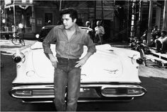 Elvis with his 1957 Imperial Crown Convertible.