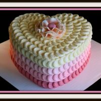 Love this romantic heart cake ... definitely takes some skill to keep the cake decorations so even and uniform
