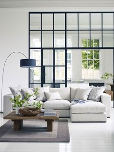 Break up a room using window panels instead of a wall as is seen in this image, raftfurniture.co.uk