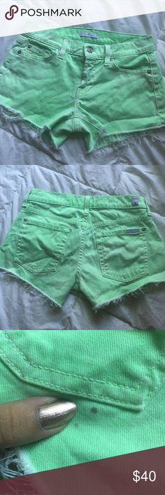 7 For All Mankind Neon Green Cut Offs Worn twice. Two small spots on the back ( see photos 2 & 3 ) They may come out I've never tried. Size 23 but could fit a 24 as well since they have stretch. 7 For All Mankind Shorts