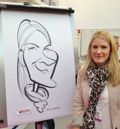 Dapper caricaturist George draws the crowds at London'd Olympia with his fast XL caricatures