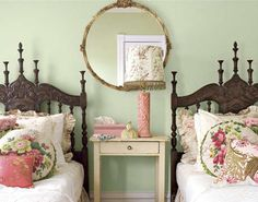 House interior tour - guest room, Anna livens a pair of dark carved oak beds with a tumble of colourful pillows