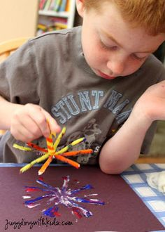 #4 of 4...Firework Painting- Dip your pipe cleaner in the paint and stamp away!  I told the kids to stamp in the same spot.  After they lift the pipe cleaner up, turn it a little and stamp again.  And repeat the process with a new color. Then sprinkle some glitter. (optional)  http://www.jugglingwithkids.com/2012/07/firework-painting.html