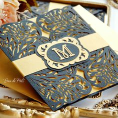 Example of invitation suite w/ laser cut folder and belly band