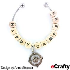 EASY DIY ~ HAPPY CAMPER BANGLE! eCrafty.com's new bangle kit (SKU 940) is so easy to use that Anne had a hard time stopping once she got going. Twist off an end bead, add beads, twist the end bead back in place and you're done! #jewelrysupplies #beads #diy #handmade #jewelry #etsy #bangle #diyjewelry #beading #crafting #bracelet #ecrafty #alphabet #personalized #letterbeads #alphabetbeads