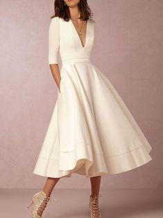 Vestido de oscilación de manga larga con cuello en V sólido sólido