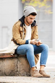 Wear a camel duffle coat and light blue jeans if you're going for a neat, stylish look. Finish it off with tan suede desert boots.  Shop this look for $189:  http://lookastic.com/men/looks/beanie-and-crew-neck-sweater-and-duffle-coat-and-jeans-and-desert-boots/3775  — Grey Beanie  — White Mohair Crew-neck Sweater  — Camel Duffle Coat  — Light Blue Jeans  — Tan Suede Desert Boots