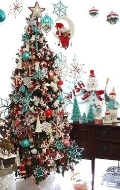 I think this is the winner! It would combine Cory's predominantly red ornaments with my turquoise. - White, Red, Silver, Gold, & Turquoise Christmas Tree