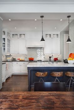 Love the navy/black island with white cabinets + white subway tile