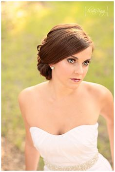 I like this simple wedding hair.  You would not have to worry about frizz from a night of dancing.