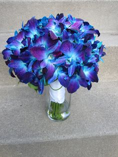 bouquet with blue orchids -  bridesmaids to have these bouquets