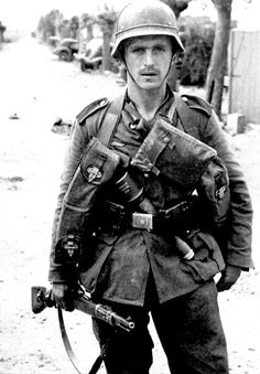 A German soldier in Dunkirk, France, carrying a K98 rifle (Summer 1940)