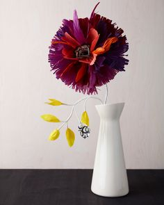 Paper flowers in fall colors by Thuss+Farrell.