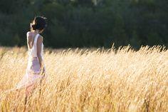 Wandering through a hayfield in a lightweight dress.