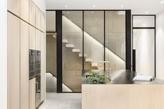 Kitchen with glass wall staircase reveal // Louise Holt