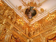 The Amber Room  in the Catherine Palace of Tsarskoye Selo near St. Petersburg (Russia) is a complete chamber decoration of amber panels backed with gold leaf and mirrors. It was created in the 18th century, disappeared during World War II, and recreated in 2003.