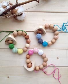 Organic teething ring toy rattle with juniper wood ring natural waldorf baby toy by amamamaekb. Explore more products on http://amamamaekb.etsy.com