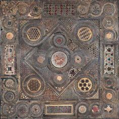 The Cosmati Pavement mosaic floor of the High Altar of Westminster Abbey . London , laid down in 1268