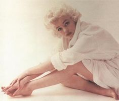 Marilyn.  I like the photos of her in a more vulnerable state.  She was so young...