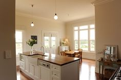Love the clean lines, openness and brightness of this kitchen, as well as the baseboards
