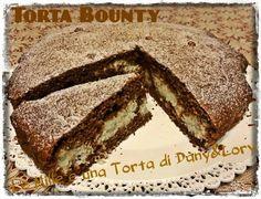Le Mille e una Torta di Dany&Lory:   TORTA BOUNTY  X la torta:  300 g farina 00 180 g zucchero  3 uova 50 g burro 130 ml acqua 1 cucchiaio + 1 cucchiaino di cacao  1/2 cucchiaino di vaniglia pura 1 bustina di lievito x dolci  X il ripieno:  2 albumi 100 g farina di cocco 70/80 g zucchero (assaggiare x vedere la giusta dolcezza) 130 ml panna liquida 1 cucchiaio di fecola di patate