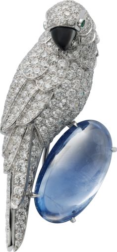 Cartier Fauna and Flora brooch Platinum, white gold, sapphire, mother-of-pearl, emeralds, diamonds