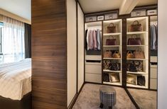 8 Ways to Squeeze a Walk-in Wardrobe in Your HDB Bedroom: Furnished with a full-length mirror, this wardrobe also features open shelves for displaying the homeowner's designer bags collection.