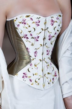 corset in gold and purple flowers on vine.  The two colors here, with the repeat of the cinching, is a great idea. Not in these patterns, but...