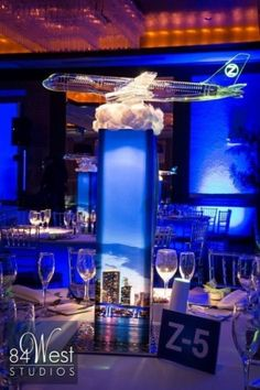 Beautiful airplane centerpieces featuring city skylines for an airplane & travel Bar Mitzvah! | MitzvahMarket.com