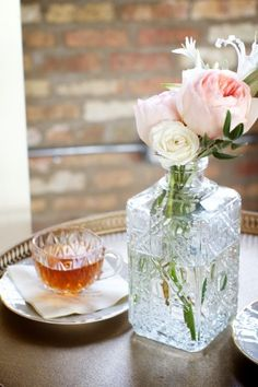 Cut-crystal whiskey decanter as vase. I love the idea of repurposing things. I have a beautiful crystal wine decanter that was my husband's great-grandmother's that I can do this with. Great idea!