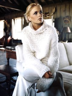 Kylie Bax in white leg trousers and chunky knit sweater photographed by Patrick Demarchelier and styled by Carlyne Cerf de Dudzeele in Marie Claire US October 1998