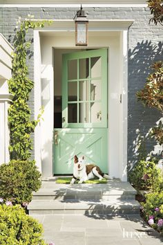 Seafoam green barn doors lend character to this home's entry.