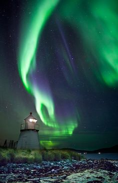 Lighthouse and Aurora Borealis outside of Tromso, nearby Skittenelv by Ole C. Salomonsen.