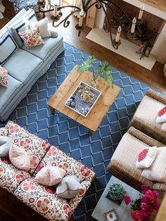 """Lively Living Room, use color daringly:  Sara Gilbane Sullivan started small, injecting easy beachy blue and white tones before throwing the vivid suzani-print sofa into the mix. """"Without this wild pop of color, the room would have felt stagnant,"""" she says."""