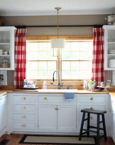 kitchen window....curtain rod above the sink...this could work!