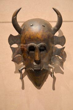 African masks by chameleonic, via Flickr