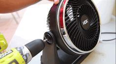 Disassemble your fan, unscrewing it from the base.