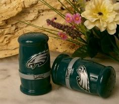 """NFL Salt and Pepper Shakers - Philadelphia Eagels - Official NFL Licensed by Encore. $22.99. NFL Licensed Product. Perfect gift for the Eagles Fan!. Philadelphia Eagles. 3 1/2 inches tall.. NFL Salt & Pepper Shakers - Philadelphia Eagles - this is likely the nicest quality salt and pepper shakers you will find, super gift for the sports fan, porcelain and comes in full color gift box. Licensed NFL product by The Encore Group. Measures 3 1/2"""" tall and the logos and print are all ..."""