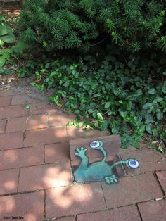 David Zinn creates poetic chalk art in the streets of Ann Arbour. He makes his cute little characters interact with objects in the street, and the result is quite charming.