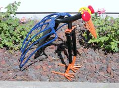 Bird Metal Sculpture Shovel Bird Yard Bird Painted Bird Yard Art Garden Art Found Objects. $134.99, via Etsy.