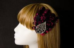 Pink and black curled feather and silver lace leaf hair fascinator on Etsy, $20.00