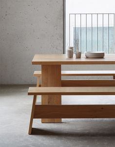 David Chipperfield has designed a solid timber table, bench and stool for German brand e15.