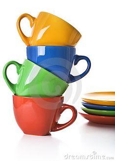 Stack of color tea cups and saucers by Larisa Lofitskaya, via Dreamstime