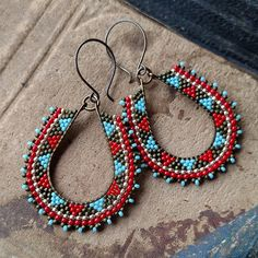 Hey, I found this really awesome Etsy listing at https://www.etsy.com/listing/272202306/red-and-blue-beaded-hoops-geometric