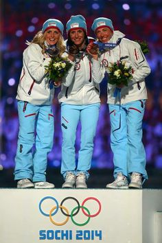 SOCHI, RUSSIA - FEBRUARY 23: (L-R) Silver medalist Therese Johaug of Norway, gold medalist Marit Bjoergen of Norway and bronze medalist Kristin Stoermer Steira of Norway celebrate in the medal ceremony for the Women's 30 km Mass Start Free during the 2014 Sochi Winter Olympics Closing Ceremony at Fisht Olympic Stadium on February 23, 2014 in Sochi, Russia.