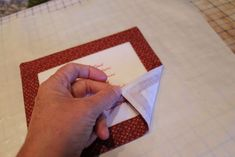 quilt label tute (uses fusible web to turn and anchor for sewing on with blind stitch)